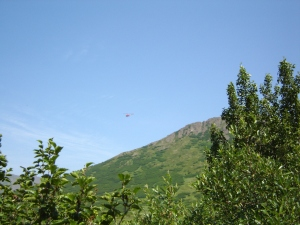 Helicopter flies over the valley