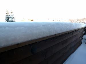 Snow accumulation on balcony railing