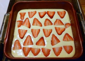 Cheesecake layer with sliced strawberries